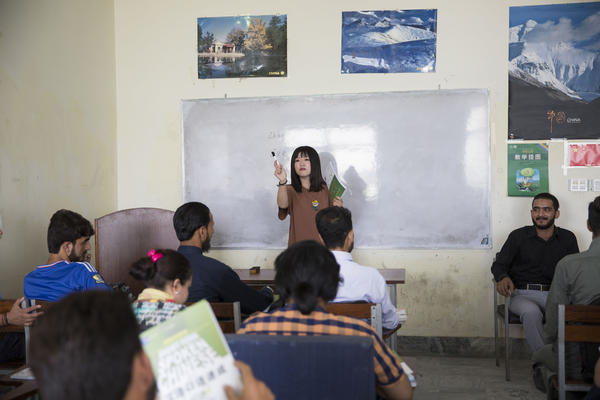 Zhou Xu is a volunteer teacher at a Mandarin class at the National University of Modern Languages in Islamabad. About 500 students are taking Mandarin, and the school has added morning and evening classes.