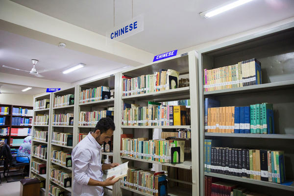 Abbas looks at books in the library at the National University of Modern Languages. Much of the rush to learn Mandarin began after Beijing and Islamabad signed a memorandum of understanding that launched the China-Pakistan Economic Corridor in 2015.