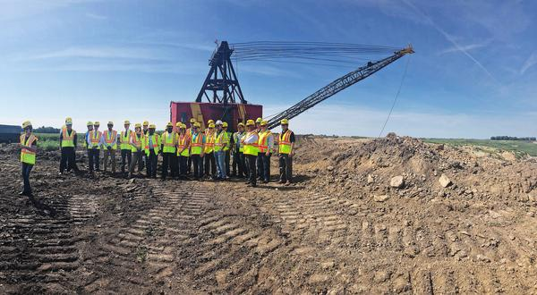 Lawmakers and advocates gather at a quarry in Athens, Illinois.