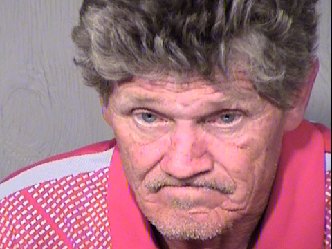 """According to a criminal complaint, Gregory Rodvelt, in a photo provided by the Surprise Police Department in Arizona from a separate incident, told law enforcement """"I would not race right in"""" to the booby-trapped home."""