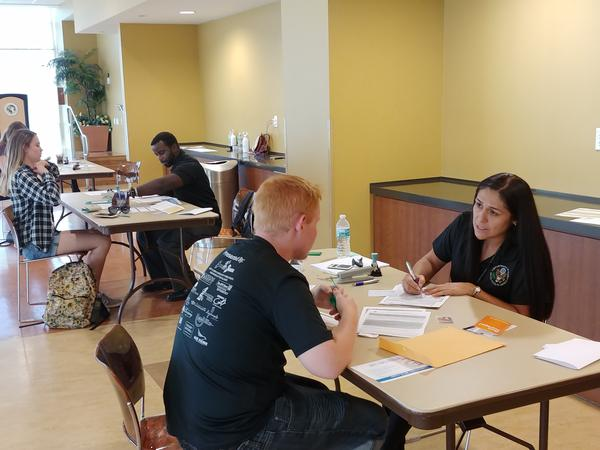 USF students interested in receiving free passports get assistance from U.S. Department of State officials at the USF Marshall Student Center in Tampa on Sept. 26.