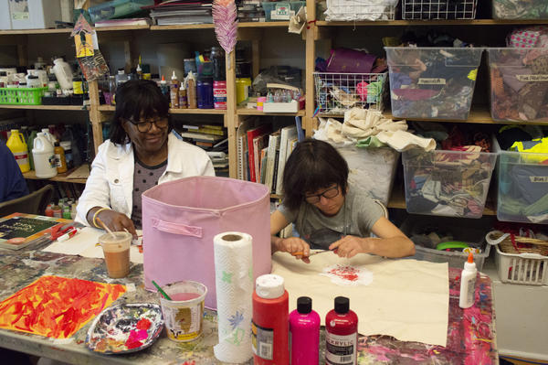 Betty Sharp, right, works with Sara Charles, left, on one of many art projects at Living Arts Studio in Maplewood.
