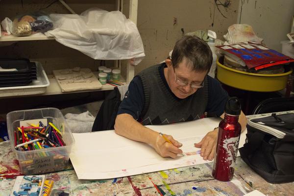 Artist Jim Santen begins one of several drawings at Living Arts Studio.
