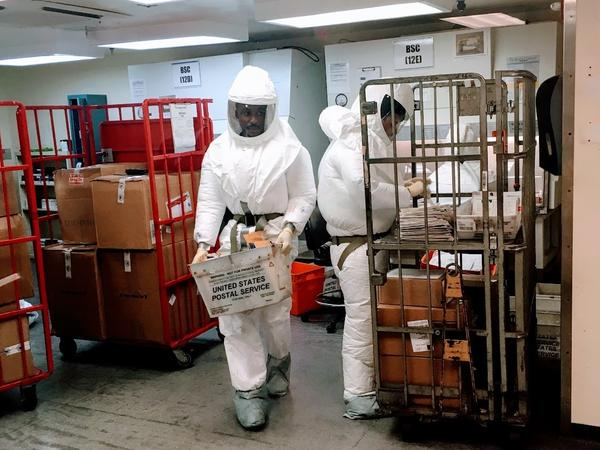 Department of Defense personnel screen mail as it arrives at a U.S. government facility in Washington, D.C., earlier this week after letters received at the Pentagon were suspected of containing deadly ricin.
