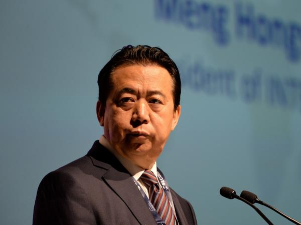 Interpol President Meng Hongwei's wife reported him missing after he left France to visit China. He's seen here during a the Interpol World Congress in Singapore last July.