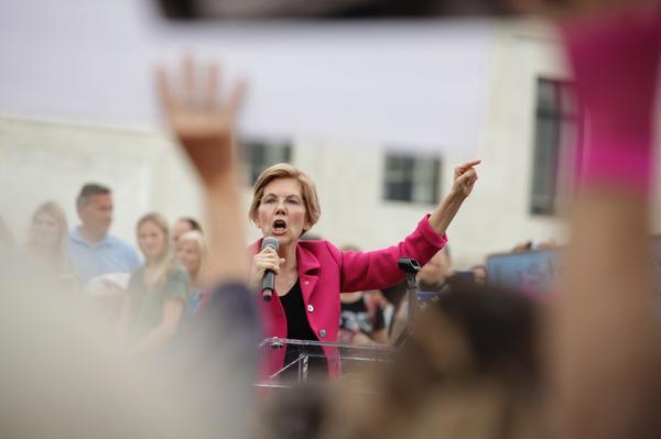 Sen.Elizabeth Warren, D-Mass., talks to protesters.