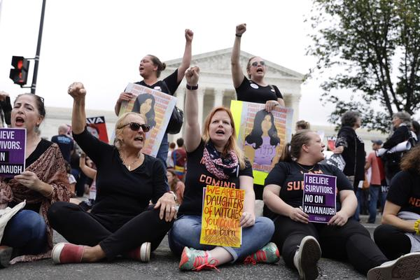 Women protest outside the Supreme Court building.