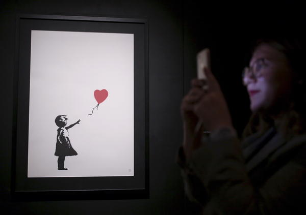 "One of Banksy's ""Girl With Balloon"" paintings is on display at an exhibition opening of works by the England-based street artist, at St. Petersburg's Manege Central Exhibition Hall in September."