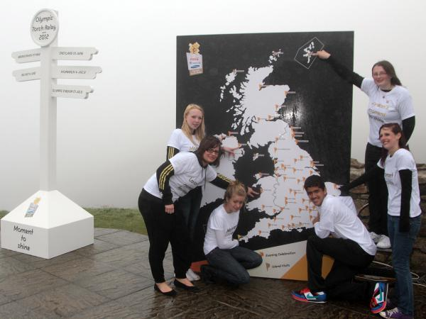 In a 2011 torch relay before the 2012 Olympic Games, 15-year-old Mhairi Gifford from Shetland points to the box.