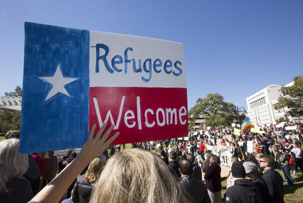Protesters demonstrate against Gov. Greg Abbott's decision to not accept refugees from Syria, at Wooldridge Park in Austin in 2015.