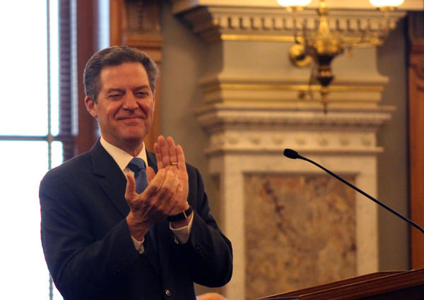 Brownback applauds during his final State of the State speech in 2018.