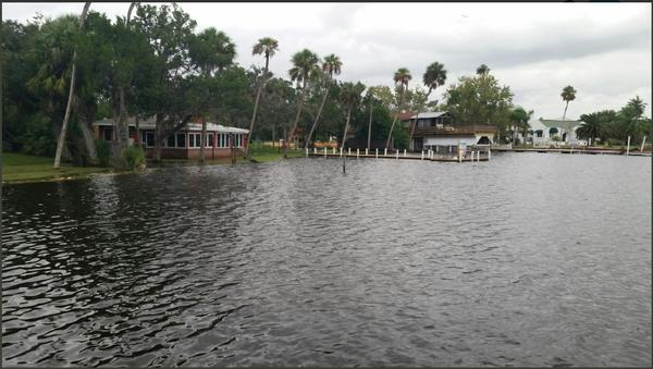 The Homosassa River rises to seawalls in Homosassa in Citrus County Wednesday morning..