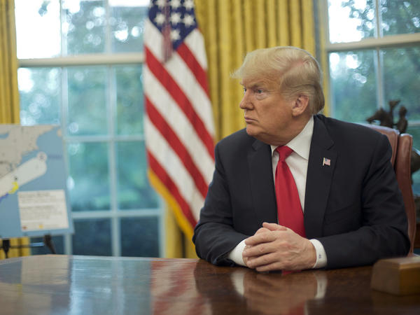 President Trump, shown in the Oval Office at the White House earlier this month, appeared on Sunday's <em>60 Minutes</em>.