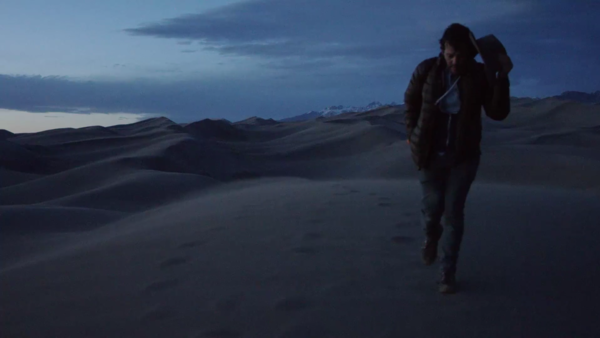 """Gregory Alan Isakov walking the Great Sand Dunes National Park in """"San Luis"""" music video."""