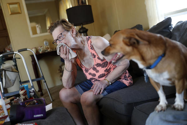Sandra Sheffield, 72, uses a washcloth to wipe sweat from her face, in her home, which now has no electricity, in the aftermath of Hurricane Michael in Panama City, Fla., Wednesday, Oct. 17, 2018.