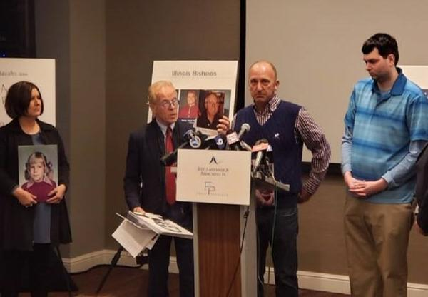 Darin Buckman addresses reporters about the alleged abuse he encountered as a child as he stands with attorney Jeff Anderson and plaintiffs Cynthia Yesko and Joshua Bollman (right).
