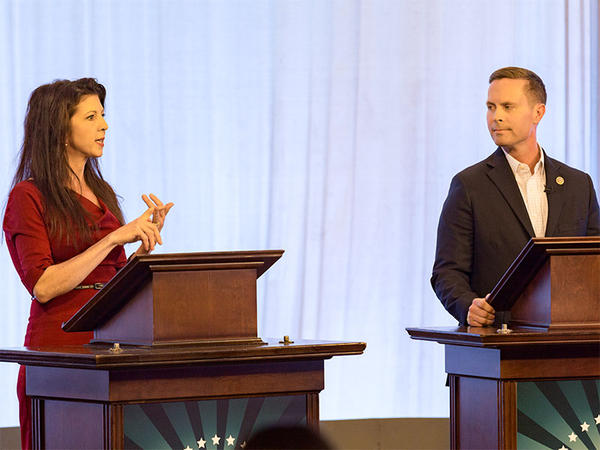 Democrat Betsy Dirksen Londrigan and U.S. Rep. Rodney Davis, a Taylorville Republican, at Thursday's debate in the WILL-TV studios on the University of Illinois campus in Urbana.