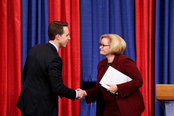 Missouri Attorney General Josh Hawley and U.S. Sen. Claire McCaskill shake hands following Thursday night's senate debate in St. Louis.