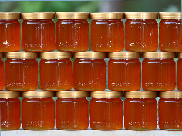Jars of honey are stacked just after harvest.