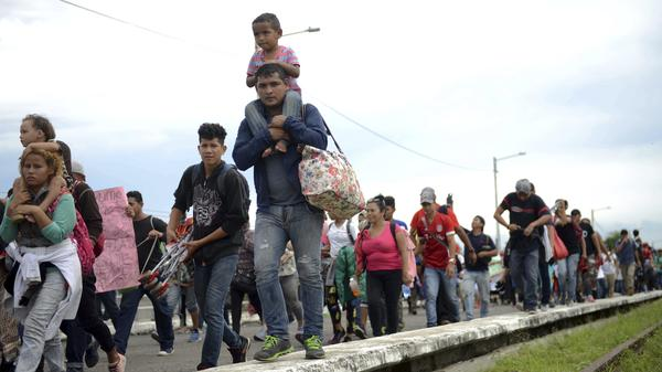 Thousands of Honduran migrants and families walk towards the southern Mexico border from Guatemala. Many say they are headed to the U.S. The White House said on Tuesday that a record number of migrant families have arrived at the Southwest border over the last year.