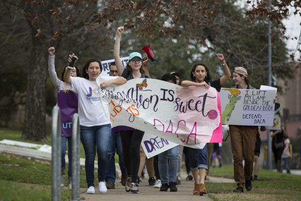 Students march from the University of Texas at Austin to the Texas State Capitol in February as part of the Migration is Sweet demonstration hosted by Jolt Texas.