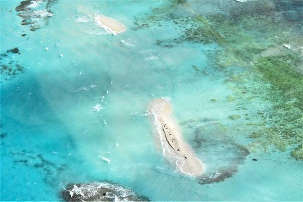 An aerial view of Hawaii's East Island after it was struck by Hurricane Walaka last month. The island, home to endangered monk seals and Hawaiian green sea turtles, nearly disappeared after the storm.
