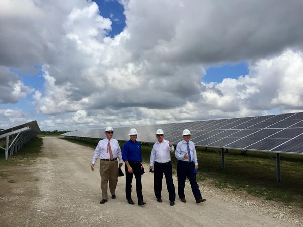 Miami-Dade County Mayor Carlos Gimenez is given a tour of the new solar site.