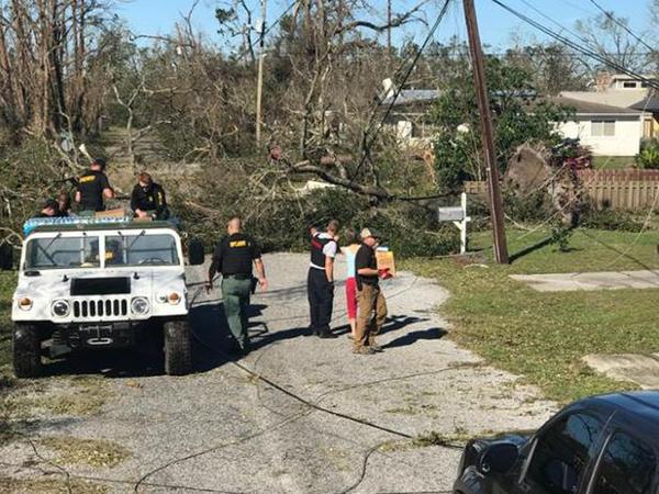 Gov. Rick Scott surveys the storm damage shortly after Hurricane Michael hit the Panhandle.