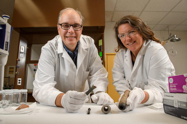 Washington State University researchers Shannon Tushingham and David Gang with some of the ancient pipes on which they found nicotine residues.
