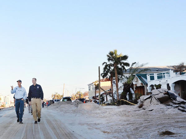 Gov. Rick Scott examines the devestation shortly after Hurricane Michael.