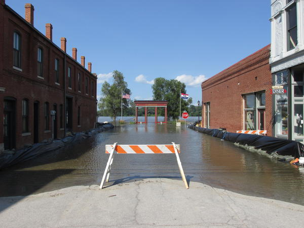 """The arch leading to a Clarksville park reads """"Touch the Mississippi."""" You could do that well up the street from the entrance during a flood in 2014."""