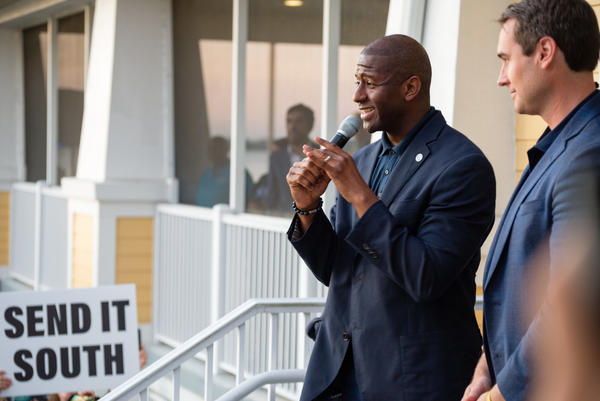 Tallahassee Mayor Andrew Gillum and his running mate Chris King address the crowd outside of Riverside Community Center in Fort Myers on Oct. 30.