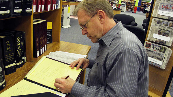 Ray Meyer researches potential employers at the library near his home in  Kirkwood, Mo. He says the uncertainty of temp work is gnawing away at him.