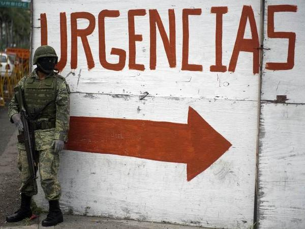 <p>A Mexican soldier takes position near the Regional Hospital of Veracruz earlier this month. The armed forces patrol the streets of the port city in an attempt to combat rising drug violence.</p>