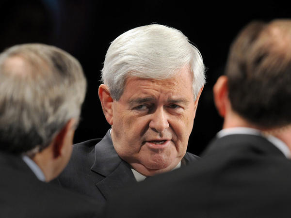 Republican presidential candidate Newt Gingrich talks with Iowa Gov. Terry Branstad (left) and PBS <em>Nightly Business Report</em> co-anchor and managing editor Tom Hudson during a Nov. 1 forum on manufacturing at Vermeer Manufacturing in Pella, Iowa.