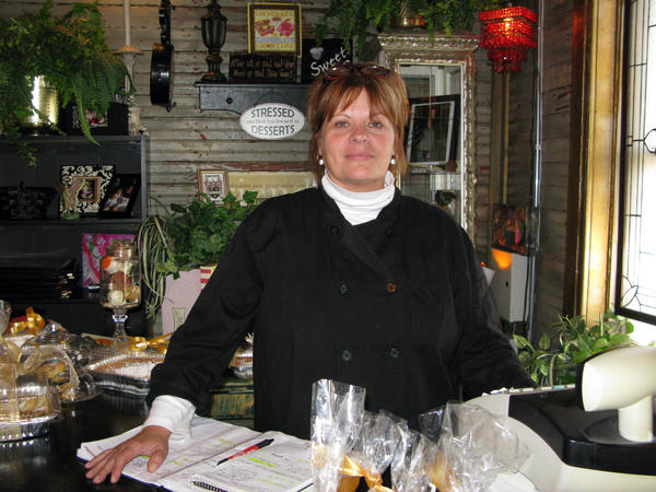 """Brenda Whitaker, owner of the Garden Gate Tea Room in Granite City, Ill., is a former steelworker and lifelong resident of Granite City. She calls her quaint restaurant """"a different world,"""" from the one she left behind in the steel mill a few blocks away."""