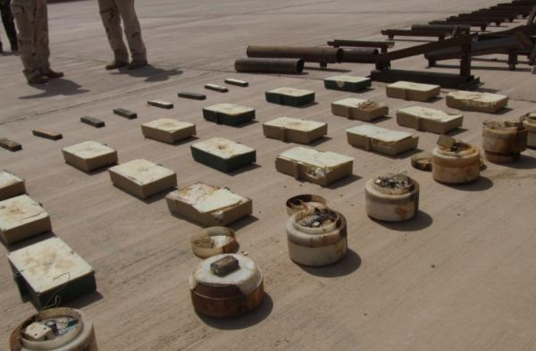 """U.S. and Iraqi soldiers display """"sticky IEDs""""  — magnetic bombs that militants attach to vehicles — found during a raid at a checkpoint near the Iraq-Iran border."""