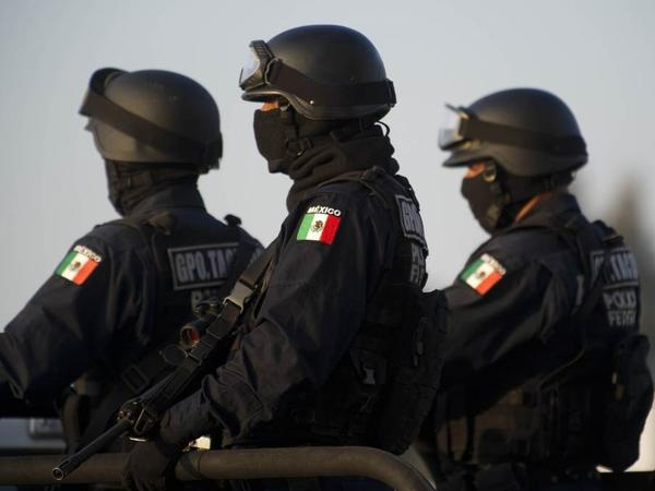 Federal policemen escort the armored car carrying a member of Los Zetas drug cartel in June. The security forces have been accused of abuses in the fight against the drug cartels.