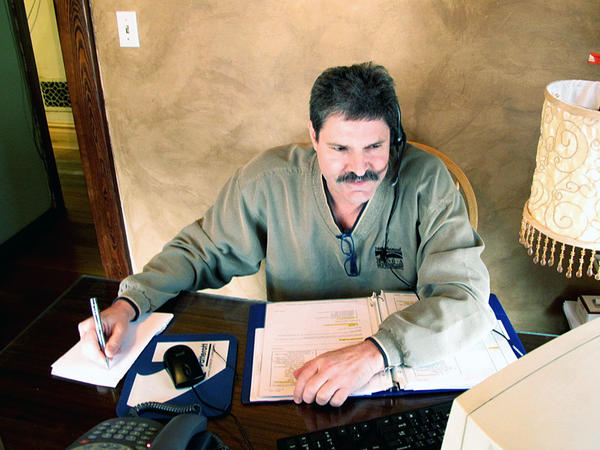 Randy Howland works in his small office in March, shortly after he began a work-from-home job with a call center earning $10 an hour.