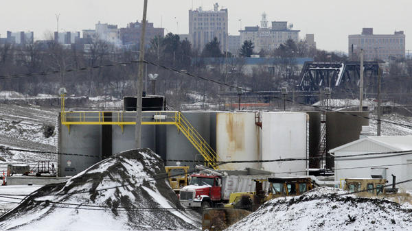 With the skyline of Youngstown, Ohio, in the distance, a brine injection well owned by Northstar Disposal Services LLC is seen in Youngstown on Jan. 4. The company has halted operations at the well, which disposes of brine used in gas and oil drilling, after a series of small earthquakes hit the Youngstown area.