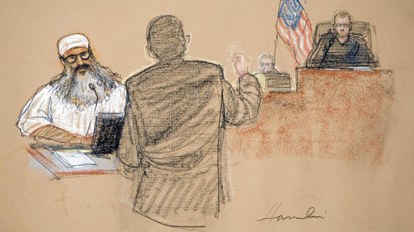 In this photograph of a sketch by courtroom artist Janet Hamlin, reviewed by the U.S. military, Khalid Sheikh Mohammed, a suspected plotter  in the Sept. 11 attacks, attends his arraignment at the U.S. Military Commissions at Guantanamo Bay U.S. Naval Base, in Cuba, on June 5, 2008. The trial for the five suspects is expected to begin sometime in the next few months.
