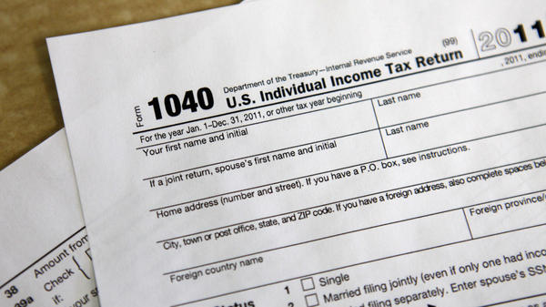As Americans prepare to file their tax returns, lawmakers take up a debate over changing wealthy earners' tax rate.