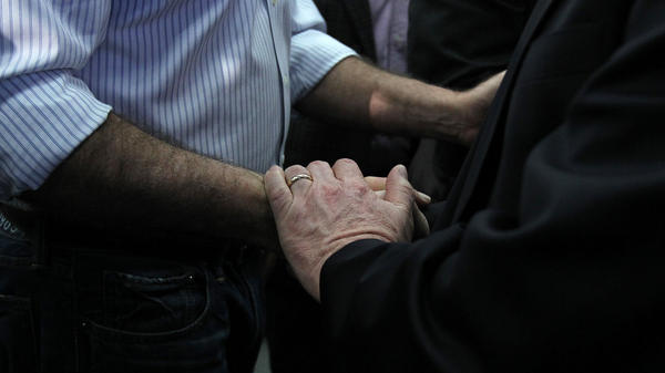 Former Massachusetts Gov. Mitt Romney shakes hands at a campaign rally at Capital University in Bexley, Ohio, on Wednesday.