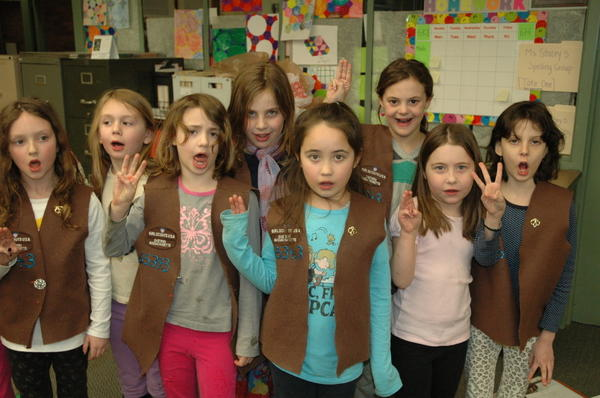 Brownies from Troop 65343 in Brookline, Mass. recite the Girl Scout pledge. Enrollment in the organization has declined since the 1980s, but a modernizing makeover and new focus on minority and immigrant communities have helped some.