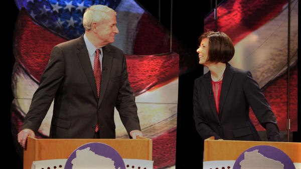 Tom Barrett and Kathleen Falk chat before the start of a live debate for Democratic gubernatorial primary candidates Friday at the Wisconsin Public Television studio in Madison. The front-runners vying for a chance to take on Republican Gov. Scott Walker in a June recall election bashed the governor during the debate. Not pictured are fellow candidates Doug La Follette and Kathleen Vinehout.