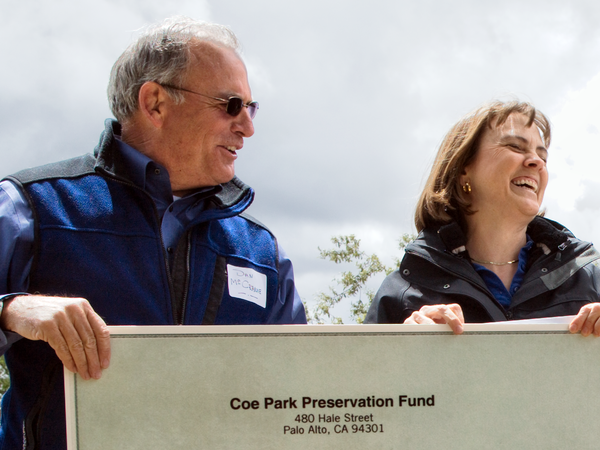 Dan McCranie (left) hands over a check for $279,000 to Ruth Coleman, director of California State Parks, at a ceremony at Coe Park in May. The amount is the first installment of about $900,000 from the Coe Park Preservation Fund that will keep the park open for three years.