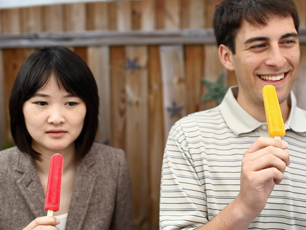 NPR interns (from left) Angela Wong and Kevin Uhrmacher participate in an experiment to induce brain freeze.