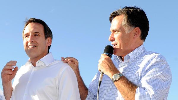 Former Minnesota Gov. Tim Pawlenty and GOP presidential candidate Mitt Romney campaign in Las Vegas on Oct.  17, 2011.