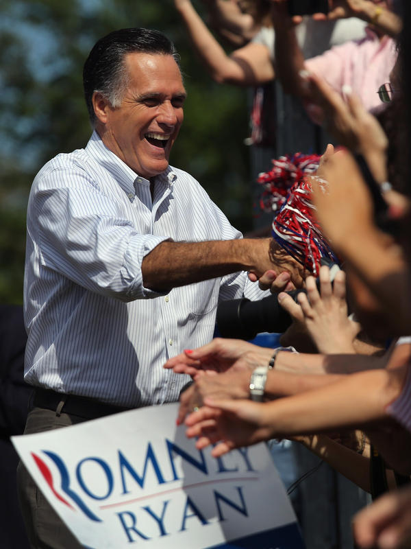 Mitt Romney greets supporters during a campaign stop at Saint Anselm College on August 20 in Manchester, N.H.