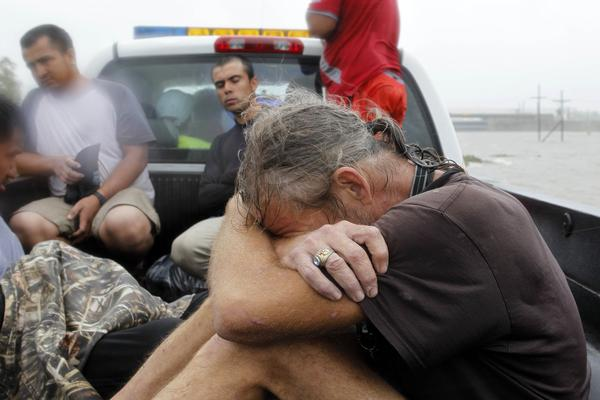Residents who were rescued from their flooded homes are transported to waiting assistance, after Hurricane Isaac made landfall and flooded homes with 10 feet of water in Braithwaite, La. Isaac was downgraded to a tropical storm Wednesday afternoon.